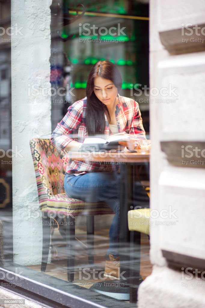 Female student doing home task at cafe, having coffee. royalty-free stock photo