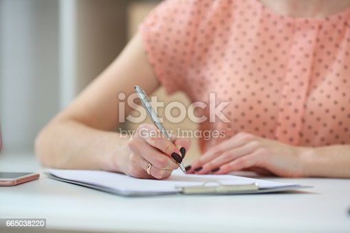 istock Female student doing homework .With depth of field image 665038220