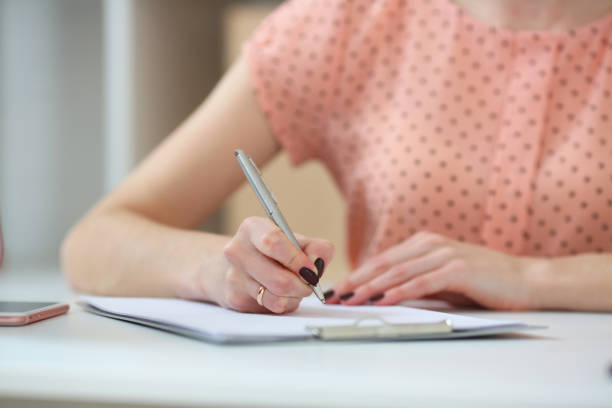 Female student doing homework .With depth of field image stock photo