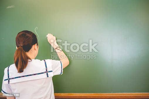 istock Female Student Doing Math at Hong Kong School, China 598697136