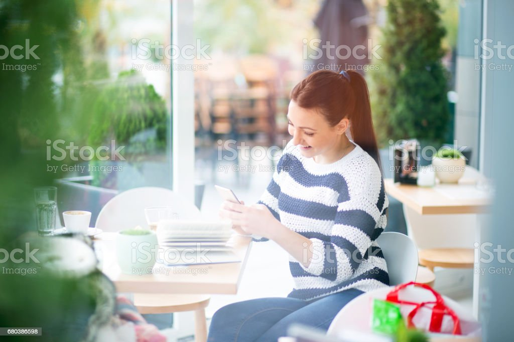 Female student enjoy a tea break royalty-free stock photo