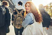 istock Female student going for class in high school 1328847023