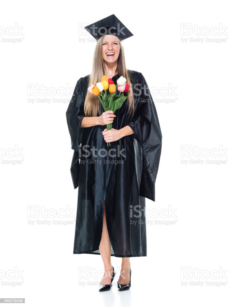 Female student graduating holding flowers stock photo