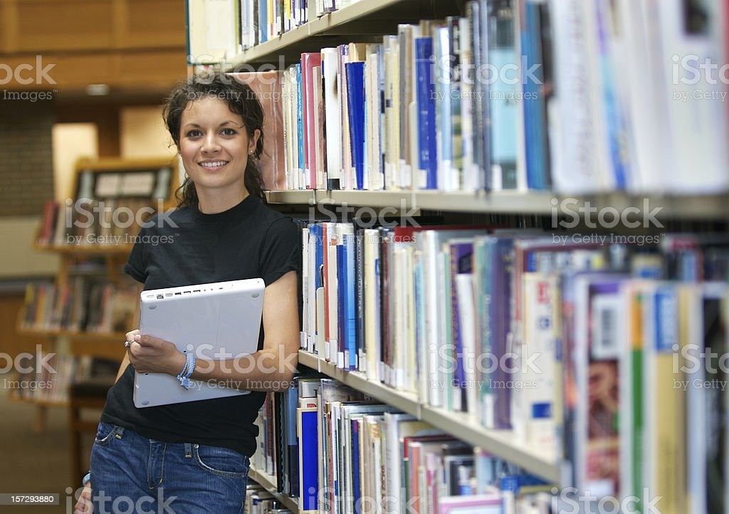 Female Student: Happy and Wired in the Library royalty-free stock photo