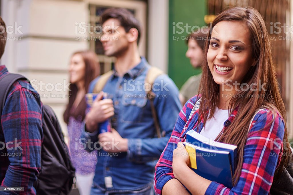 Female student holding her books stock photo