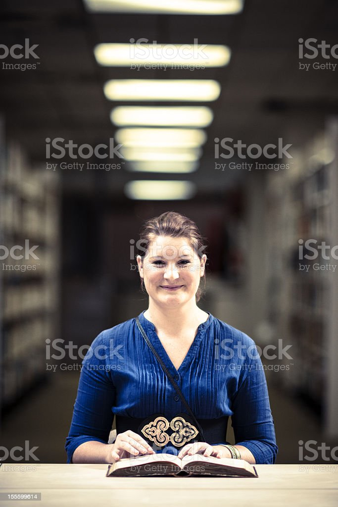 Female student in library royalty-free stock photo