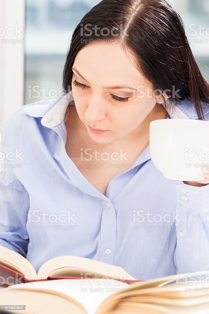 Female Student learning at home with different books royalty-free stock photo