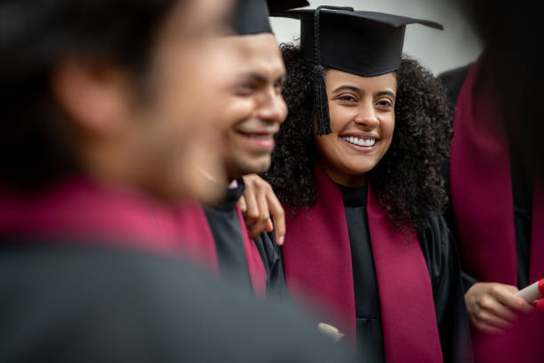 Female student looking happy on her graduation day stock photo