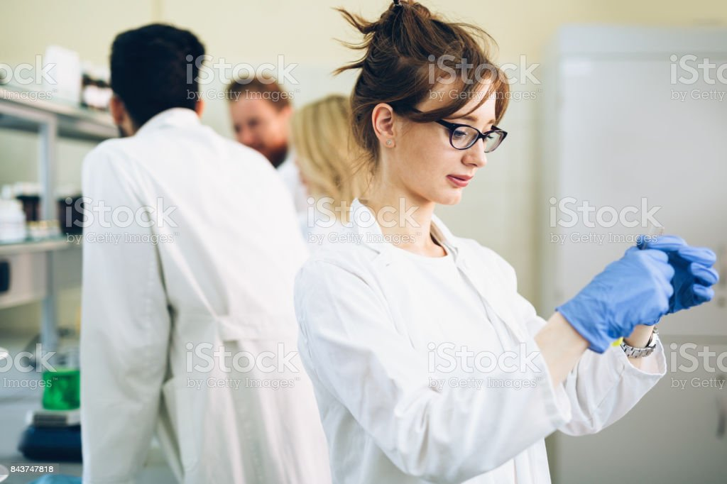Female student of chemistry working in laboratory stock photo