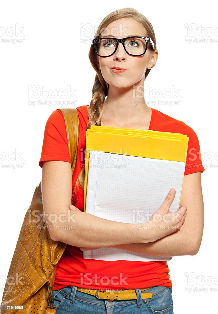 Female student Portrait of college student standing with bag and workbooks against white background, looking up. Studio shot. 18-19 Years Stock Photo