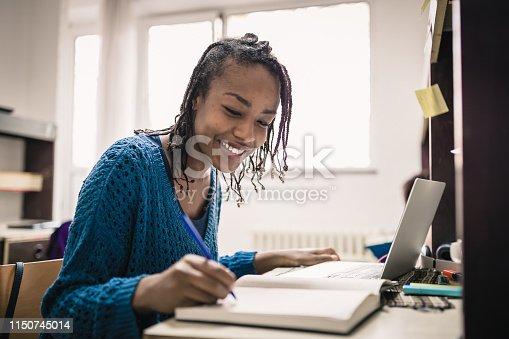 istock Female student preparing exam 1150745014