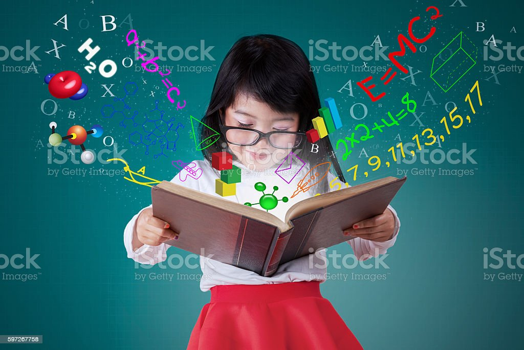 Female student reading book with formula Lizenzfreies stock-foto
