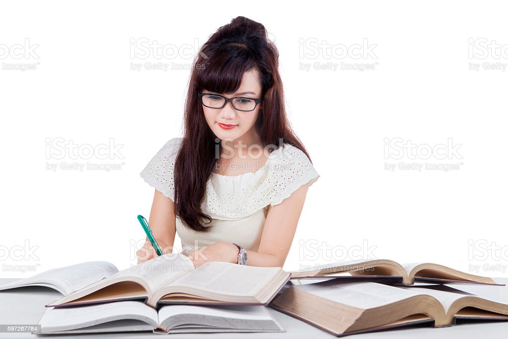 Female student reads book and writing royalty-free stock photo