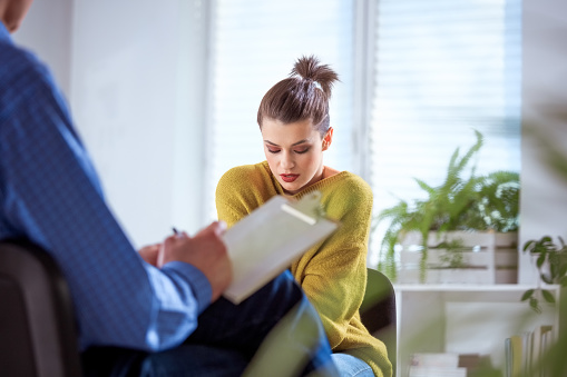 Female Student Sharing Problems With Therapist Stock Photo - Download Image Now