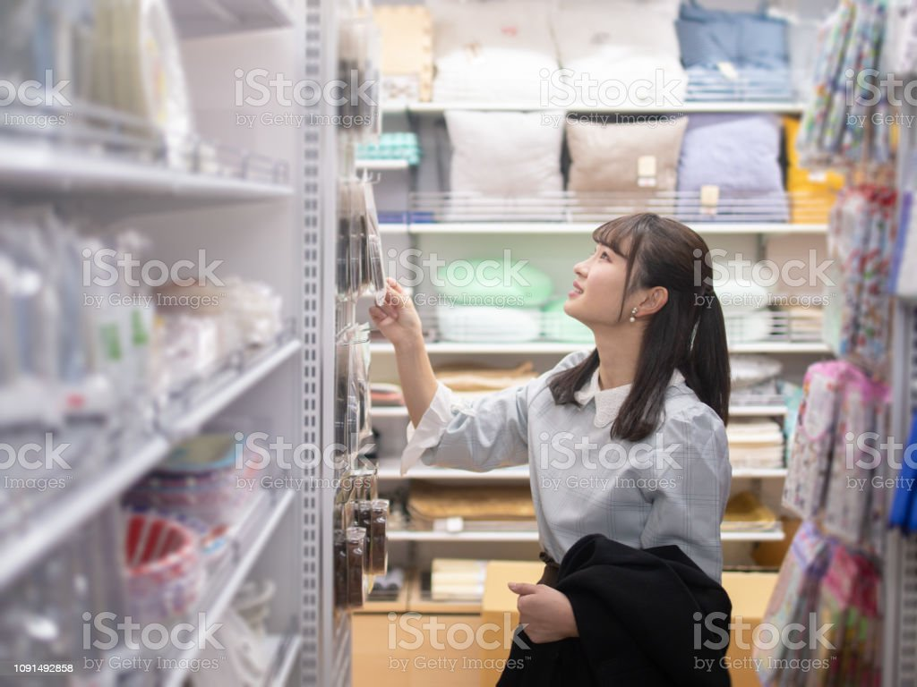 detailed pictures attractive price authentic quality Female Student Shopping At Discount Store Stock Photo ...