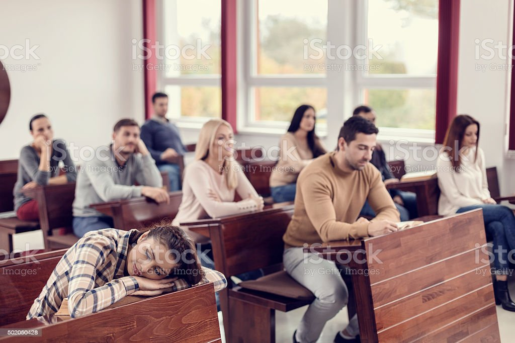 Female Student Sleeping in Classroom stock photo