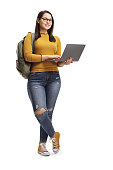 istock Female student standing and posing with a laptop computer 1148986977