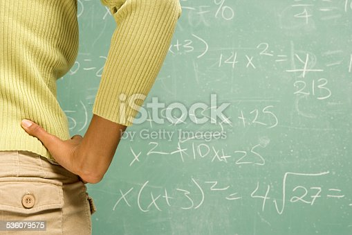 istock Female student stood in front of blackboard 536079575