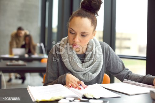 istock Female student studying in a library 490520653
