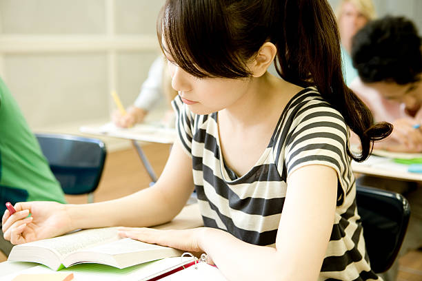 Female student studying in classroom stock photo