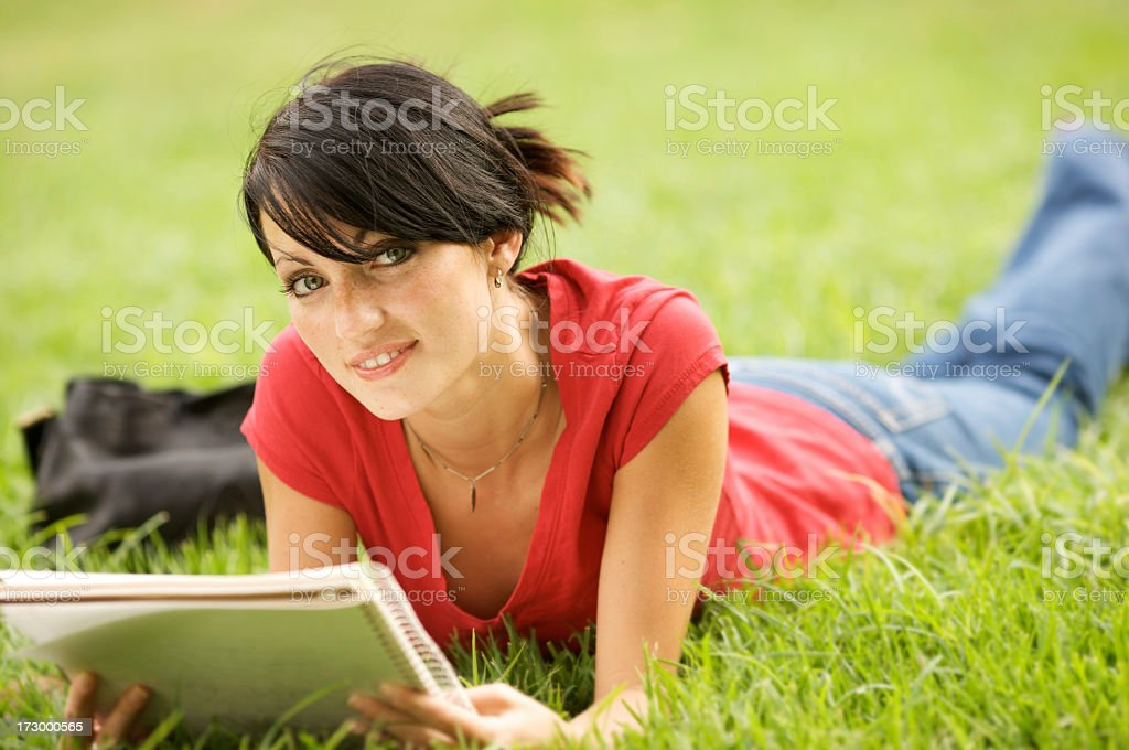 Female student studying on grass royalty-free stock photo