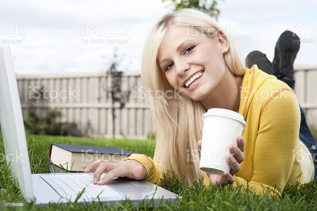 Female student studying on laptop royalty-free stock photo