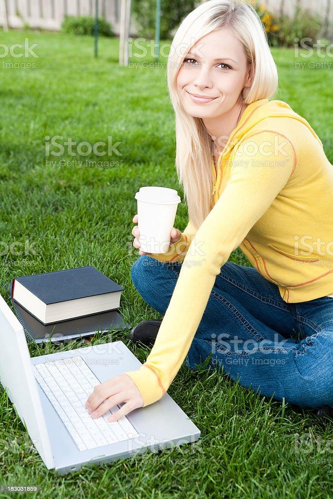 Female student studying on laptop royalty-free stock photo