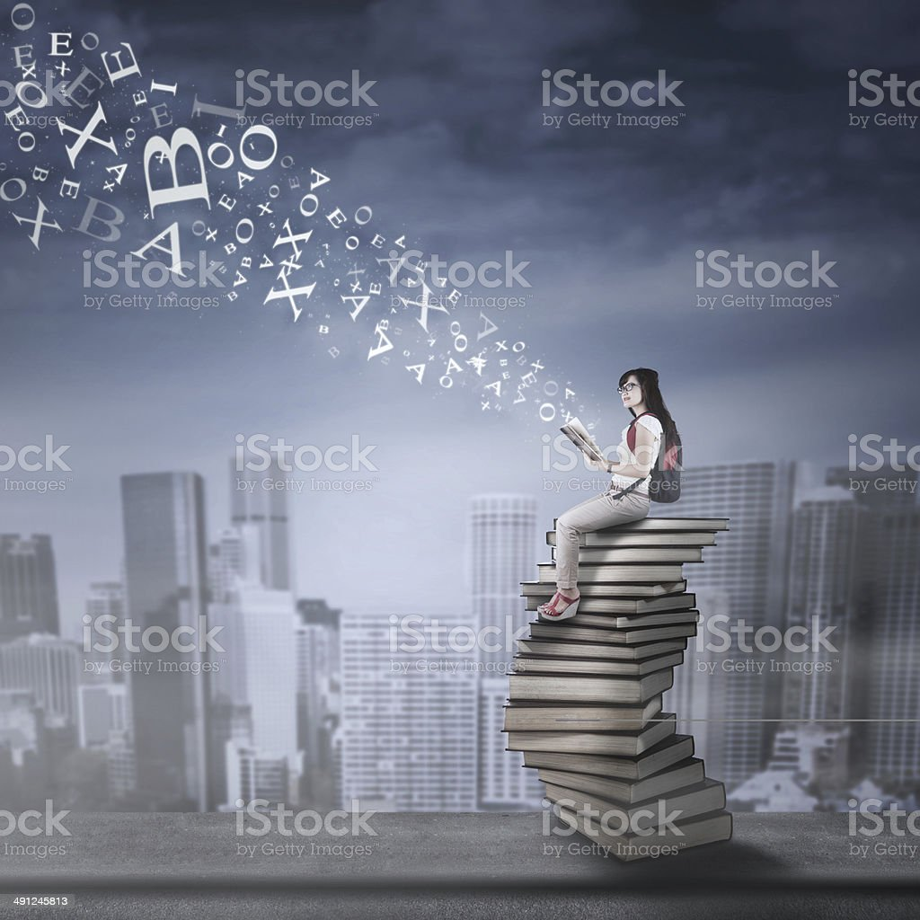 Female student studying on rooftop 1 stock photo