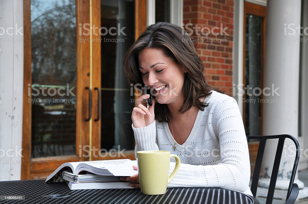 Female Student Studying with Textbooks and Coffee royalty-free stock photo