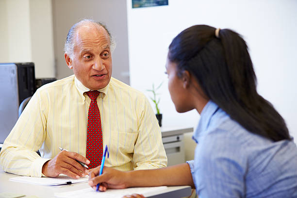 female student talking to high school counselor - school counselor stock pictures, royalty-free photos & images