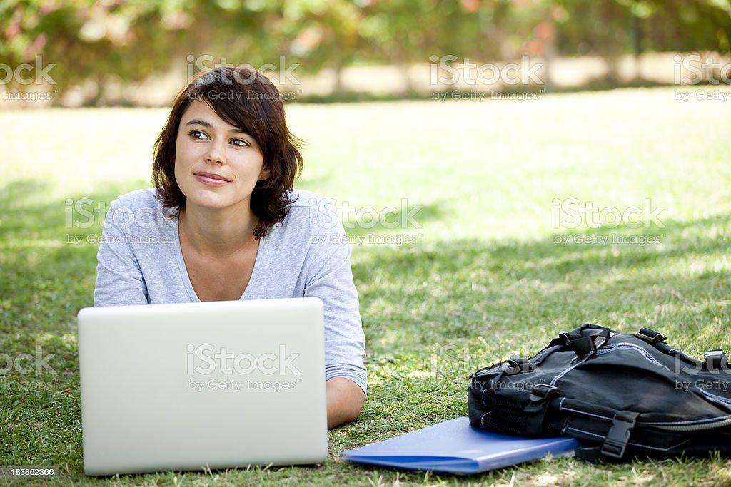 Female student thinking while using laptop royalty-free stock photo