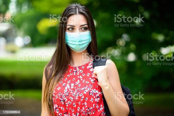 Female student walking outdoor in the park and wearing a mask to picture id1250698804?b=1&k=6&m=1250698804&s=612x612&h=b2nfyh7da 9sge1kqgodmqtuv6dqagxwt1okeokkpnk=