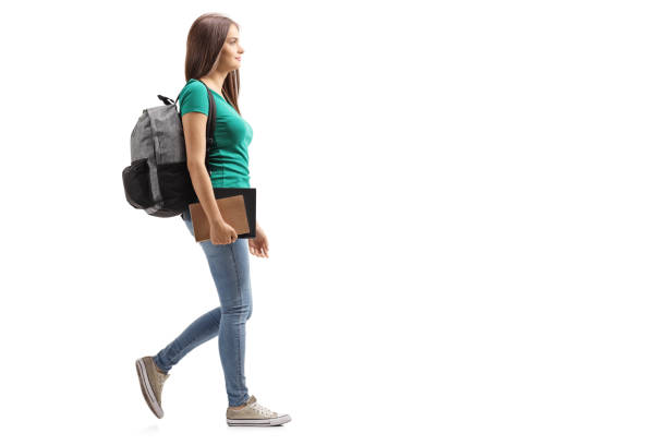 Female student with backpack walking stock photo