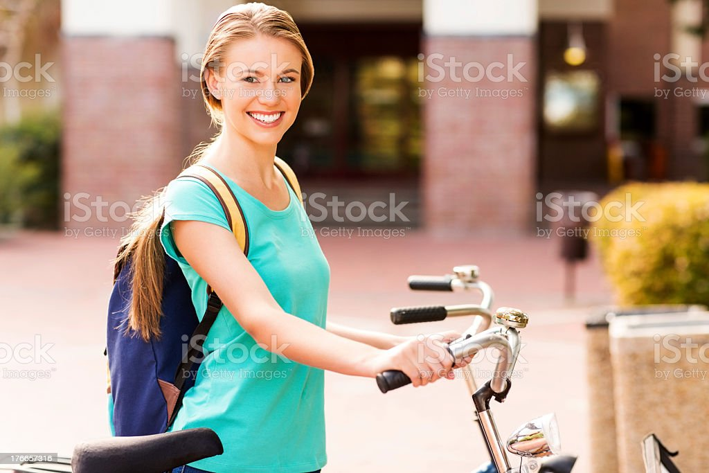 Female Student With Bicycle Standing On Campus royalty-free stock photo