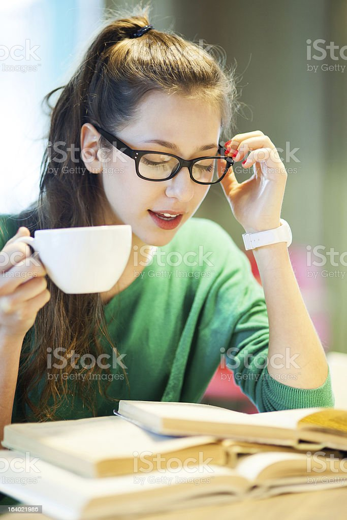Female student with books and cup of coffee royalty-free stock photo