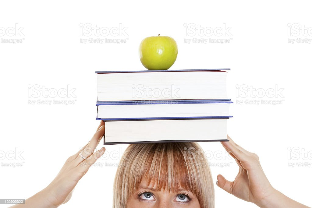 Female student with books on her head royalty-free stock photo