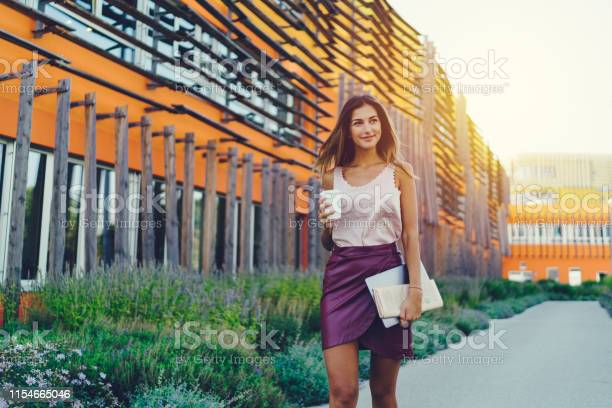 Female student with coffee walking outside picture id1154665046?b=1&k=6&m=1154665046&s=612x612&h=v1e2ofzuhjfb cjvn3lyuzv3qo69pvi1zxdmmdwmrhg=