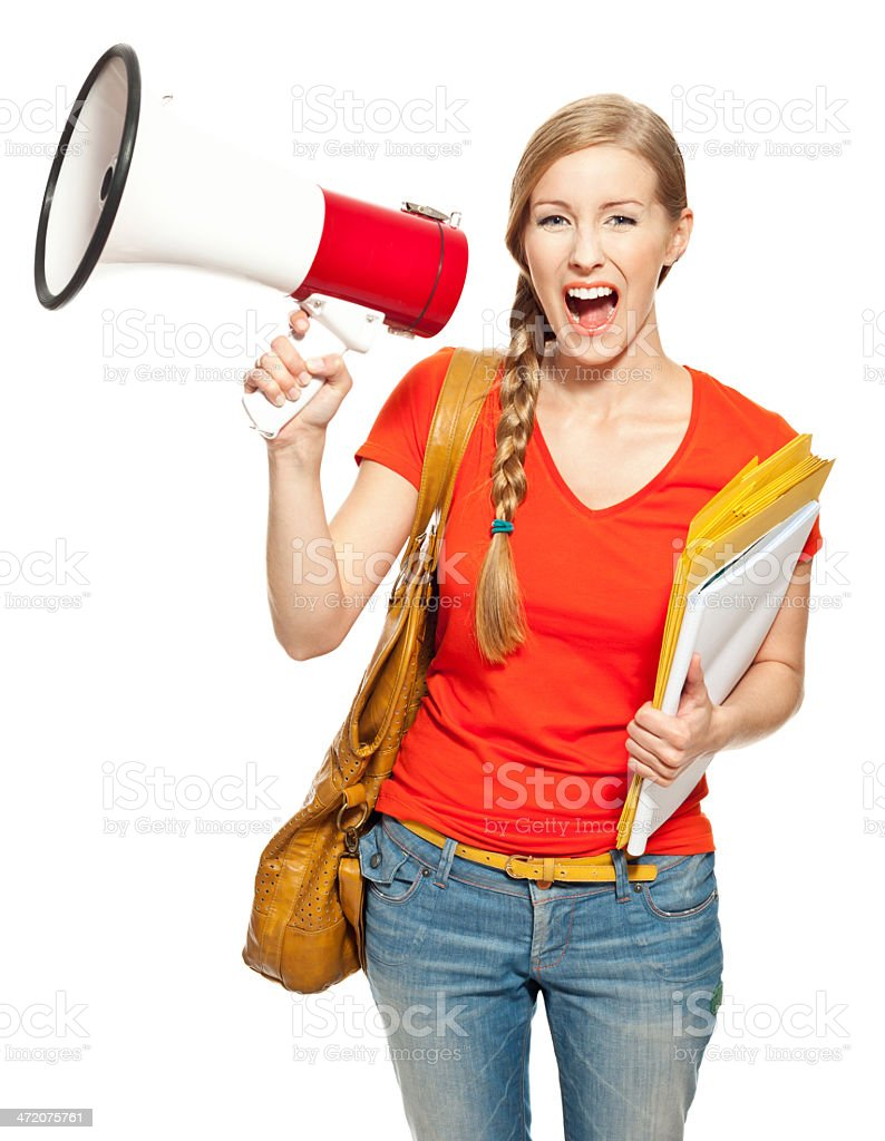 Female student with megaphone Portrait of college student standing with bag and workbooks against white background and screaming into megaphone. Studio shot, white background. 18-19 Years Stock Photo