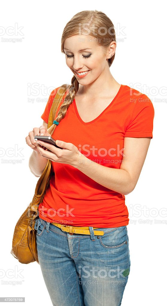 Female student with smart phone Portrait of smiling young woman texting on smart phone. Studio shot, white background. 18-19 Years Stock Photo