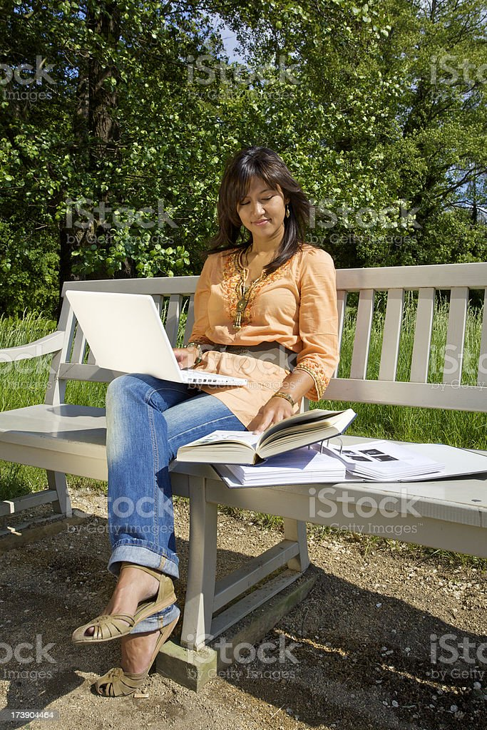 Female student working in park royalty-free stock photo