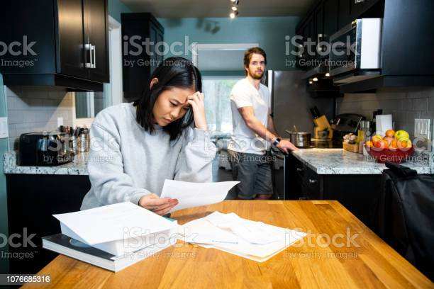 Female student worrying about financial issues at home in her with picture id1076685316?b=1&k=6&m=1076685316&s=612x612&h=m j1cumrdjwjmj5 yqyzi66 sop39r u1dfaijd2gt8=