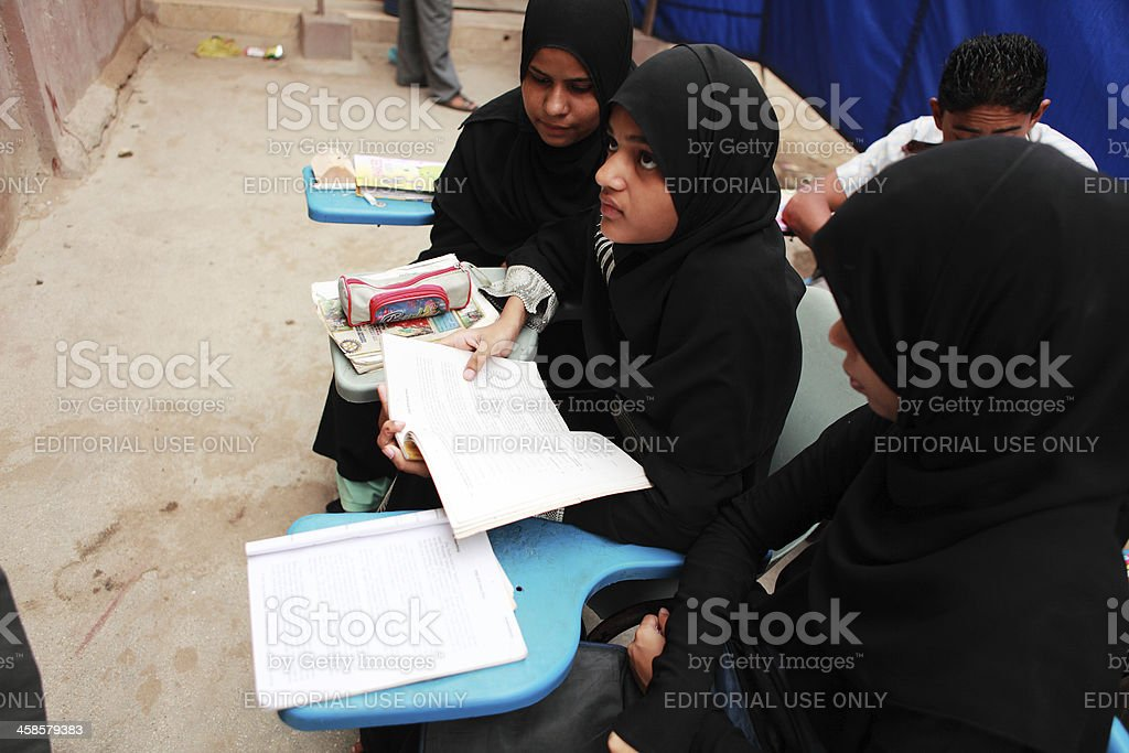 Female Students attends class in Street School run by ARM stock photo