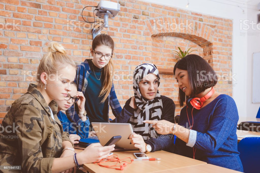 Female students during break in classroom stock photo