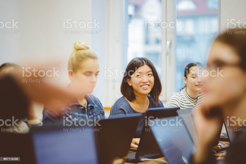 Female students during computer programming class stock photo