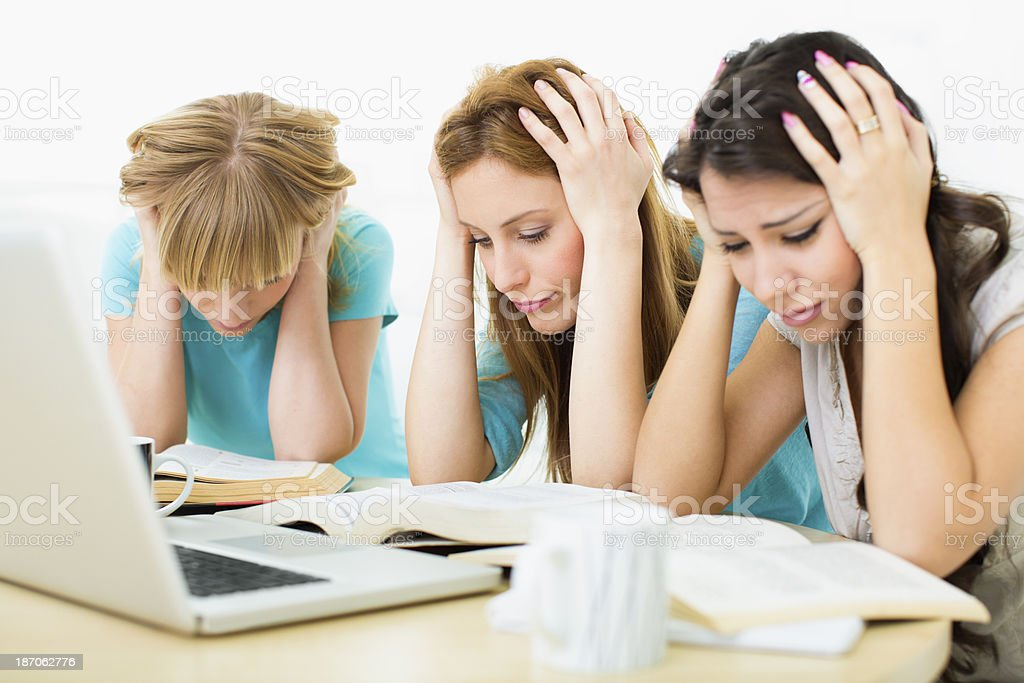 Female students exhausted of learning. royalty-free stock photo