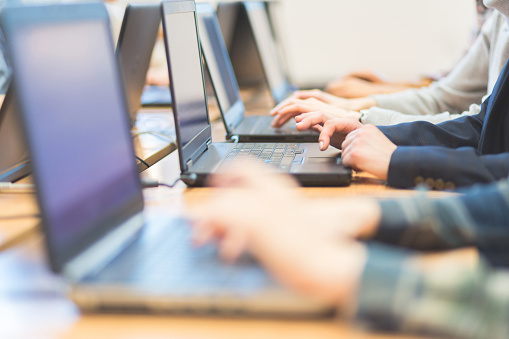 Female Students Learning Computer Programming Stock Photo - Download Image Now