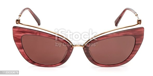 Female Sunglasses coral plastic vintage isolated on white background. Summer womens sun eye glasses front view.