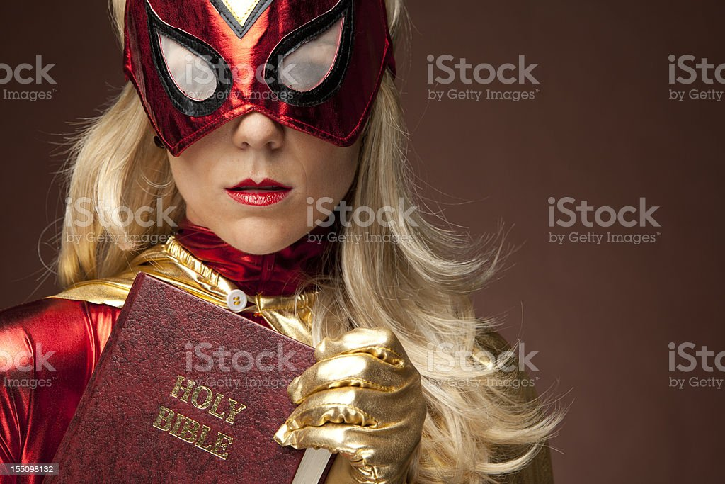 Female Superhero Holding Bible Stock Photo & More Pictures of