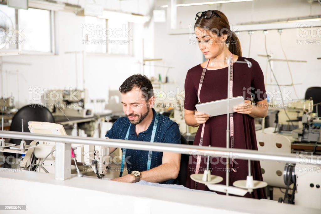 Female supervisor in a textile factory stock photo