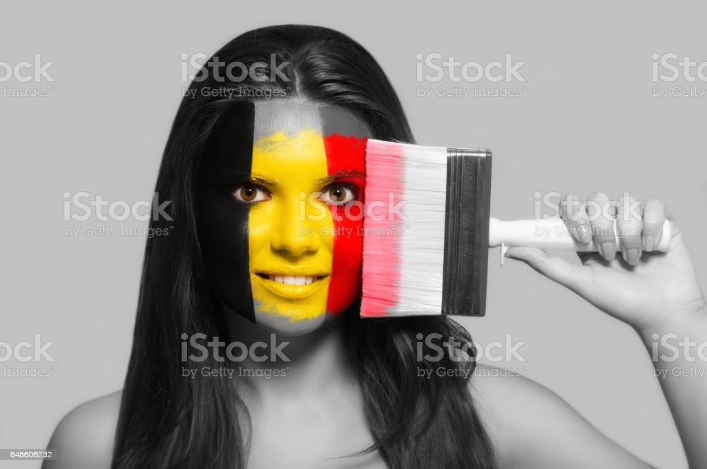 Female supporter in national colors of Belgium stock photo
